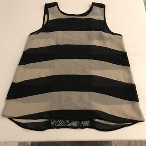 Tops - Black and white  striped shirt.